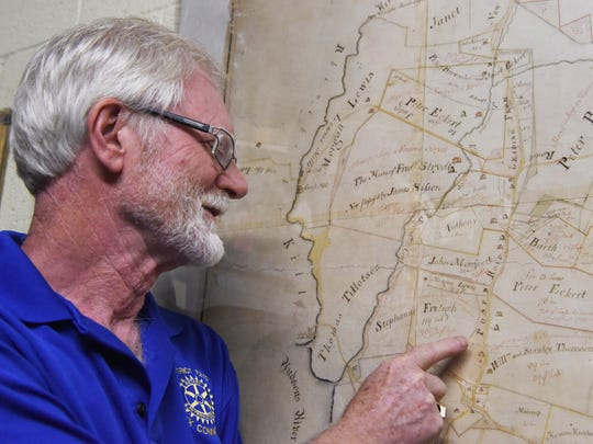 Michael Frazier, archivist for the Rhinebeck Historical Society, points out Albany Post Road on an 1802 map of the southern part of the Town of Rhinebeck.