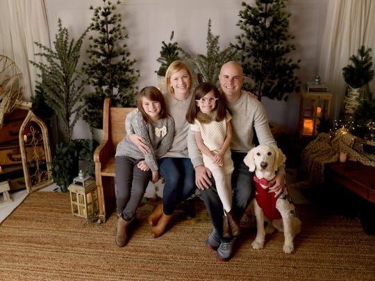 """The Cawley family of Medina, Ohio, and their service dog Strax are featured in the Netflix documentary series """"Dogs,"""" which also includes the Gogolewski family of West Chester."""