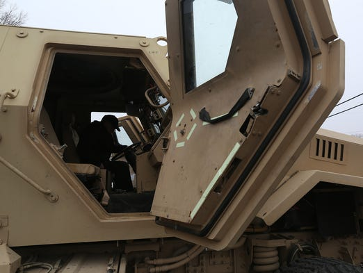 MRAPs (mine resistant ambush protected) vehicles are the newest hand-me-downs to come from the military to law enforcement agencies in Iowa. The latest of seven MRAPs to arrive in Iowa was received last week by the Washington Police Department. Former Sheriff Yale Jarvis checks the vehicle out from the drivers seat Thursday, April 3, 2014.