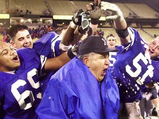 Former St. Xavier coach Steve Rasso celebrates with his players.