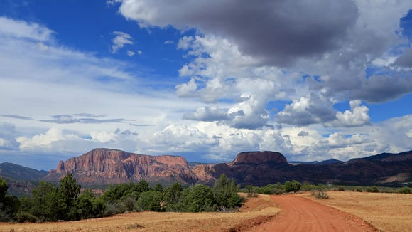 The colors of Smith Mesa and the surrounding cliffs change with weather and the seasons.