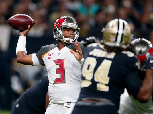 Tampa Bay Buccaneers quarterback Jameis Winston (3) passes under pressure from New Orleans Saints defensive end Cameron Jordan (94) in the first half of an NFL football game in New Orleans, Sunday, Nov. 5, 2017. (AP Photo/Butch Dill)