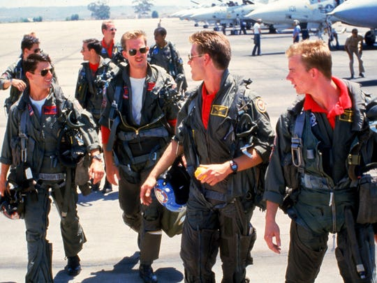 "Tom Cruise (from left) and Anthony Edwards, rocking the coveted aviators in the original ""Top Gun."""