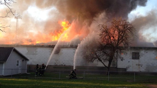 Firefighters are shown responding to a structure fire on Friday, April 11, 2014, on South Draper Street on Indianapolis' Near Eastside.