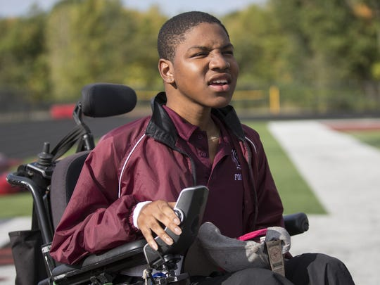 Emanuel Duncan, who has Duchenne Muscular Dystrophy, at a football practice for Lawrence Central High School, Indianapolis,, Oct. 13, 2015.