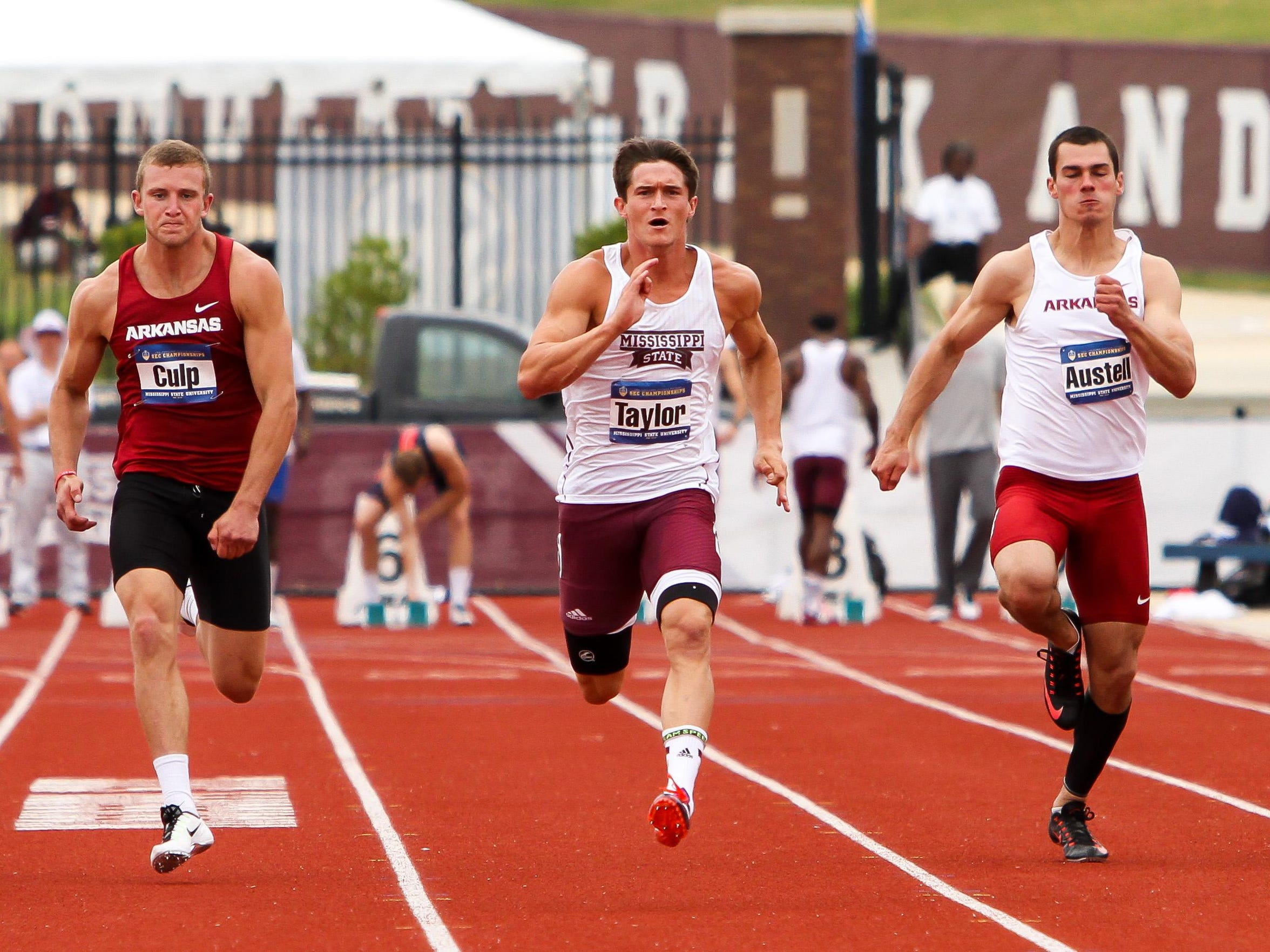 Zach Taylor sprints during the 100-meter event during