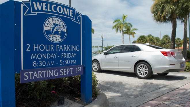 A sign at the entrance of a parking lot on Orange Avenue and Indian River Drive informs the public of the 2-hour parking limit Aug. 9, 2016 in Fort Pierce.
