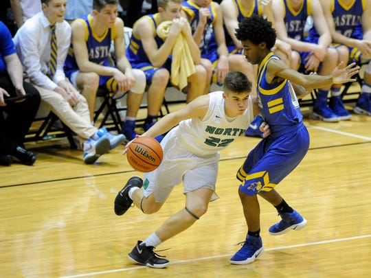 North's Cameron Seaton (22) drives past Castle's Shawn Young jr. (10) during their game at North High School, Tuesday, Feb. 7, 2017. Castle beat North 102-54.