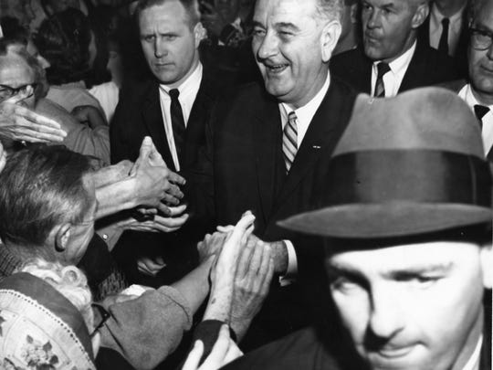 President Lyndon B. Johnson shaking hands with the crowd at Palm Springs Municipal Airport c. 1964.