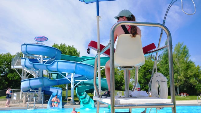 Activity picks up at Electric City Water Park and Mitchell Pool on Friday as temperature approaches 100 degrees.