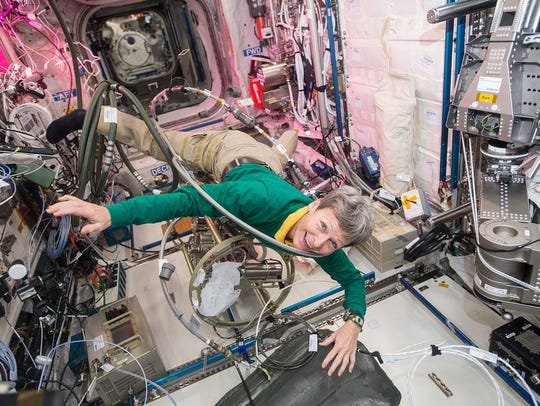NASA astronaut Peggy Whitson floats through a tangle