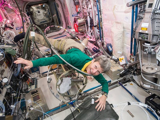 NASA astronaut Peggy Whitson floats through a tangle of cables inside the Columbus module aboard the International Space Station in this Dec. 8, 2016, photo provided by NASA. Whitson was operating the Fluids System Servicer to refill coolant loops in multiple modules on the U.S. segment of the station.