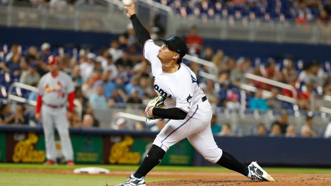 Miami Marlins' Jordan Yamamoto delivers a pitch during the fifth inning of the team's baseball game against the St. Louis Cardinals, Wednesday, June 12, 2019, in Miami. Yamamoto pitched seven innings and won his major league debut in the Marlins' 9-0 victory. (AP Photo/Wilfredo Lee)