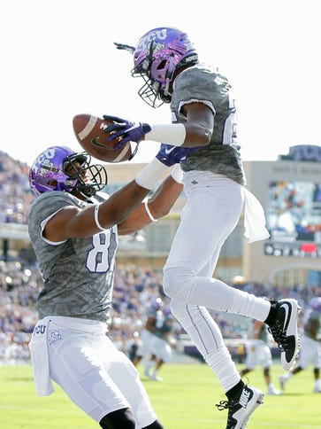 TCU wide receiver KaVontae Turpin (right) and teammate