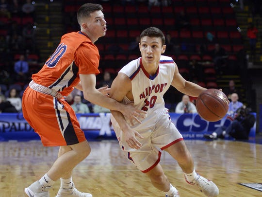 Fairport's Dan Masino, right, drives past Liverpool's Peter Cerrone during the state boys basketball Class AA semifinal in Binghamton, N.Y. on Saturday, March 18, 2017. Fairport advanced to the championship game with a 69-52 win.