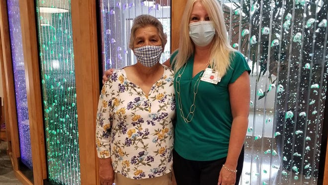 Margaret Pardini, a lung cancer patient who participated in a clinical trial is with Lynn Harrision, a clinical research nurse at the SECU Cancer Center.