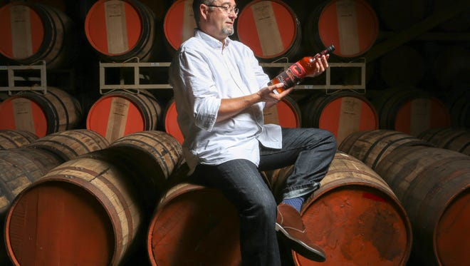 Copper & Kings Master Distiller Joe Heron with his new apple brandy called Floodwall.July 19, 2016