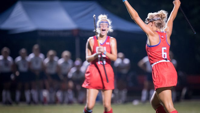 """Christian Academy of Louisville's Maddie Coombe celebrates after a goal during the Championship Game of the 2017 Apple """"Stick it to Cancer"""" Field Hockey Tournament played against Sacred Heart Academy in Louisville, Ky., Friday, August 25, 2017. Christian Academy of Louisville defeated Sacred Heart Academy 3-2."""