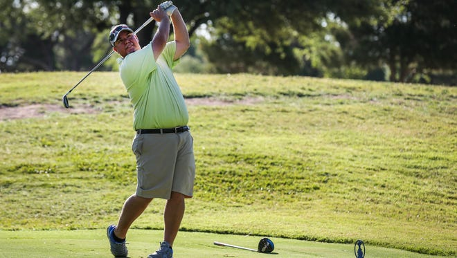Cory Adams tees off on the third hole during the 59th San Angelo Country Club Men's Partnership Thursday, June 21, 2018.
