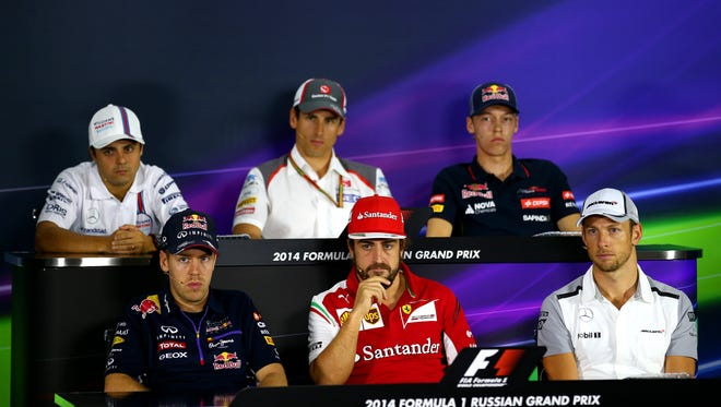 From back left to right, Felipe Massa, Adrian Sutil and Daniil Kvyat attend a press conference in Sochi, Russia with, from front, left to right, Sebastian Vettel, Fernando Alonso and Jenson Button Thursday.