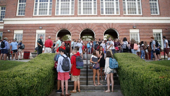 Leon High School students congregate outside of the school before the first day of classes last year.