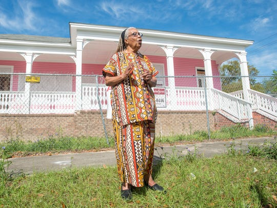 Georgia Blackmon, president of the Mother Wit Institute, talks about the historic Ella Jordan Home in Pensacola on Tuesday, March 20, 2018.  The Mother Wit Institute, a Pensacola nonprofit organization that owns the home, will be holding a Rockathon fundraiser to help restore the building.