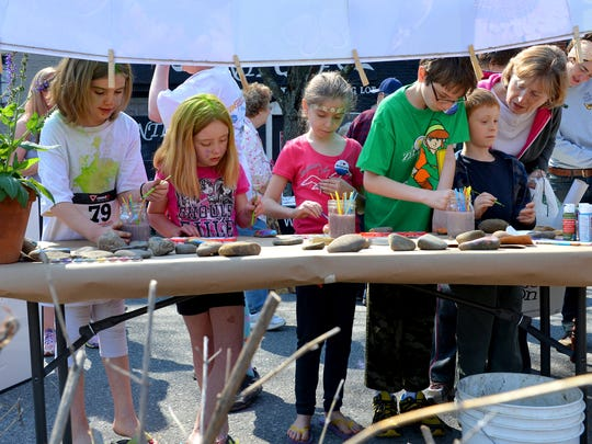 Children paint rocks at The Natural Garden's table during last year's Earth Day Staunton.