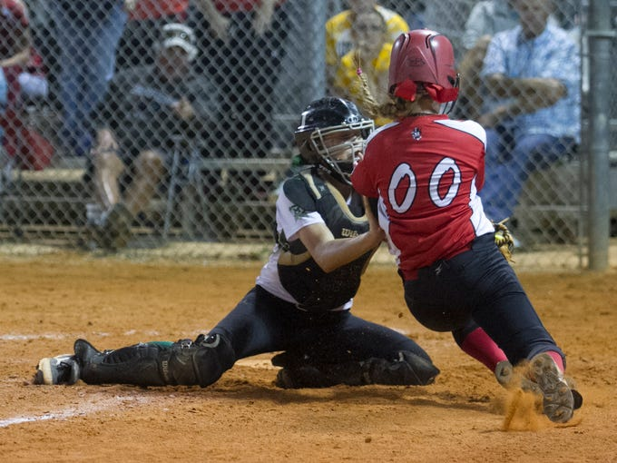 Hannah Perkins of Fort Myers tags out  Summer Ackerson
