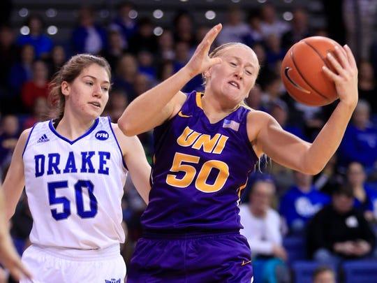 Megan Maahs of UNI comes down with a rebound as Sara
