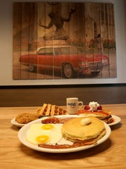 An order of chicken and waffles, New York cheesecake pancakes, eggs, bacon and pancakes.