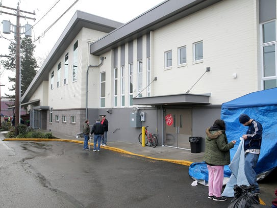 People who normally sleep at the Bremerton Salvation Army camped outside of it on Wednesday.