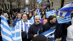 Greek-Americans gather as they prepare to march in