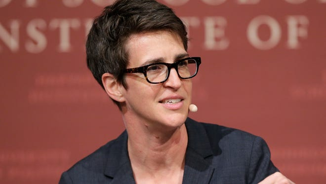 MSNBC political commentator Rachel Maddow is pictured moderating a forum panel at the John F. Kennedy School of Government at  Harvard University.