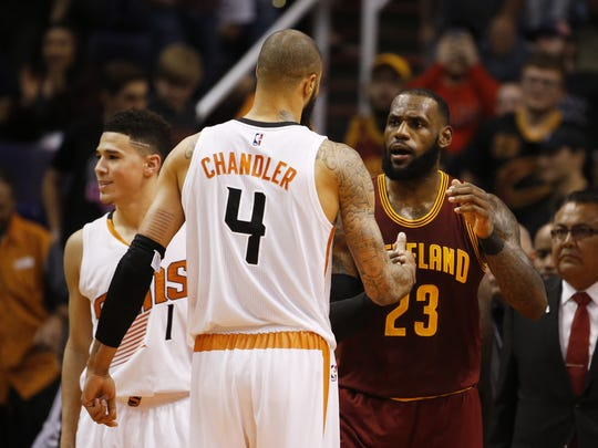 LeBron James hugs Suns center Tyson Chandler after the visiting Cavaliers beat Phoenix on Jan. 8.