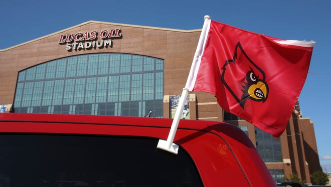 U of L fans tailgate outside the Lucas Oil Stadium ahead of the U of L-Purdue football game in Indianapolis.Sep. 2, 2017