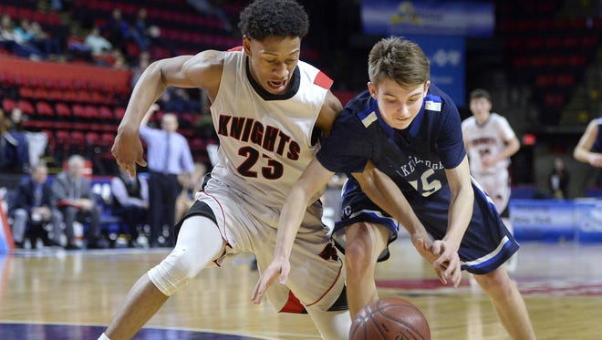 Northstar Christian's Miles Brown, left, steals the ball from Lake George's Alex Jones during the state Class C semifinal on Friday, March 17, 2017.