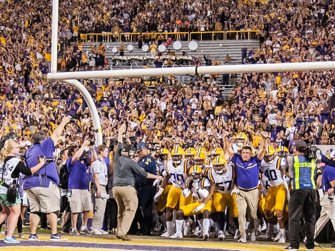 LSU Tigers head coach Ed Orgeron taking the field as the Alabama Crimson Tide play the LSU Tigers in Baton Rouge on Saturday night in Death Valley, November 5, 2016. BUDDY DELAHOUSSAYE/ THE ADVERTISER