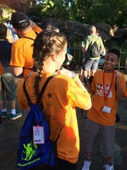 McGary Middle School students Thomas Hampton and Shelby Butler hang out at Animal Kingdom on Friday morning.