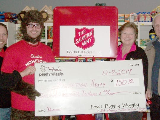 This past December, Fox's Piggly Wiggly, with the help of Bob Maloney of Shoreline Credit Union, was able to donate $150 to Shorelilne Credit Union, who was going to match that donation and present it to Salvation Army. Presenting the check was Peggy Jeske, store director Manitowoc Piggly Wiggly, to Kyle Bryntesen, development officer from Shoreline Credit Union, and Joe Franz from Kiwanis ringing bells for Salvation Army.
