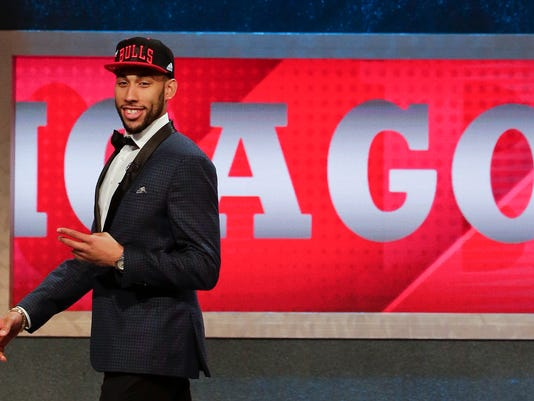 Denzel Valentine walks off stage after being selected 14th overall by the Chicago Bulls during the NBA basketball draft, Thursday, June 23, 2016, in New York. (AP Photo/Frank Franklin II)