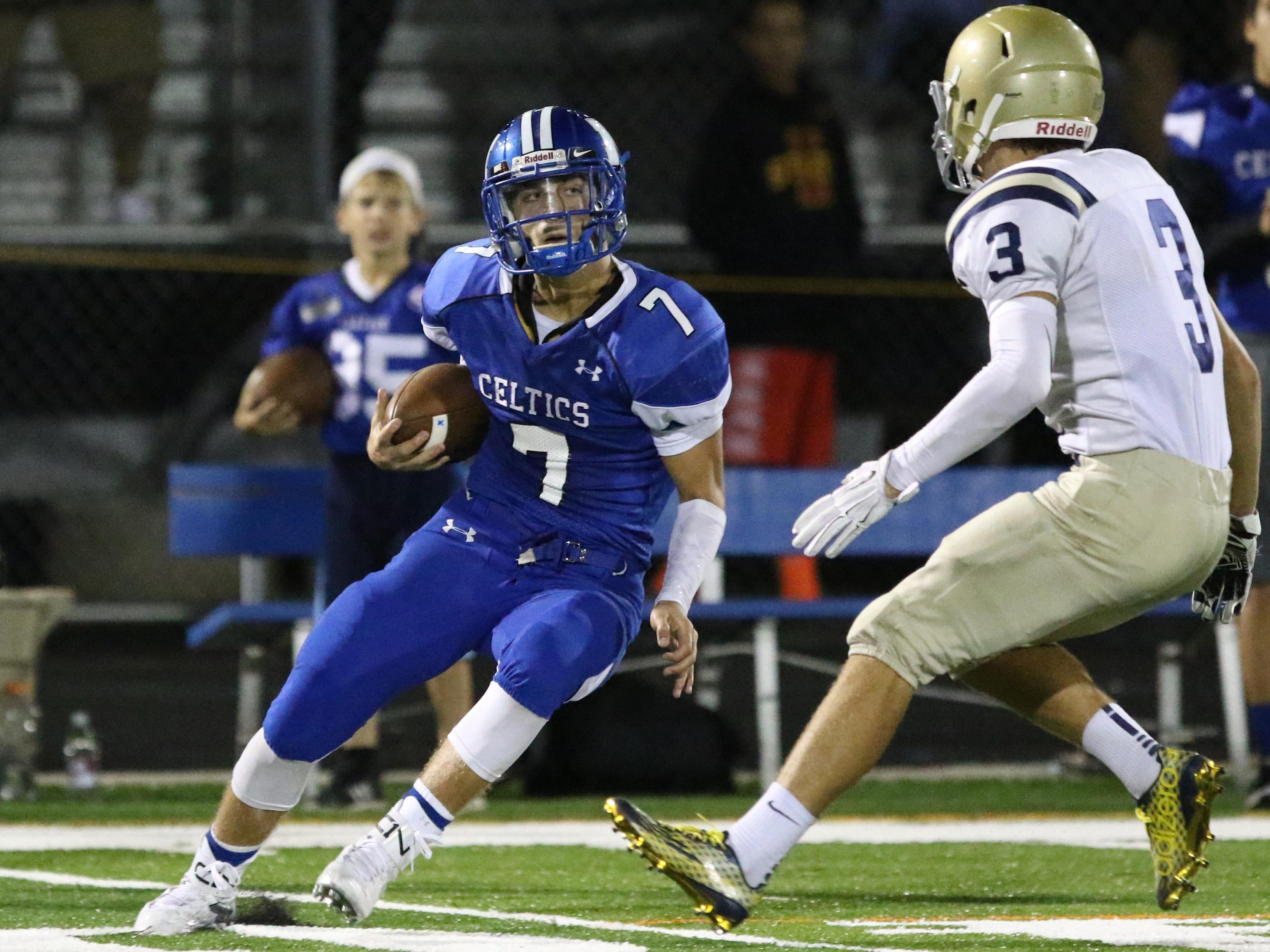 McNary's Trent Van Cleave runs the ball as the Celtics defeat West Albany 31-22 in a Greater Valley Conference game on Friday, Sept. 18, 2015.
