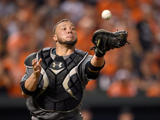 Arizona Diamondbacks catcher Welington Castillo makes a catch on a bunt pop-up by Baltimore Orioles' Michael Bourn for the out during the ninth inning of a baseball game, Friday, Sept. 23, 2016, in Baltimore. (AP Photo/Nick Wass)