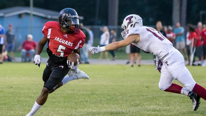 Keyshawn Helton (5) evades Aggie defender Ethan Rowland (17) for a big gain during the Tate vs West Florida high school football at Woodham Middle School in Pensacola on Friday, September 1, 2017.