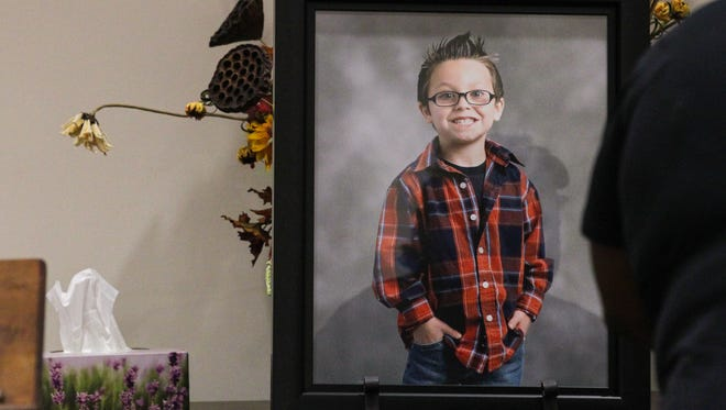 A framed photograph of Jacob Hall near a box of tissues in the lobby of the church, during the funeral service for him on Oct. 4, 2016 at Oakdale Baptist Church in Townville.