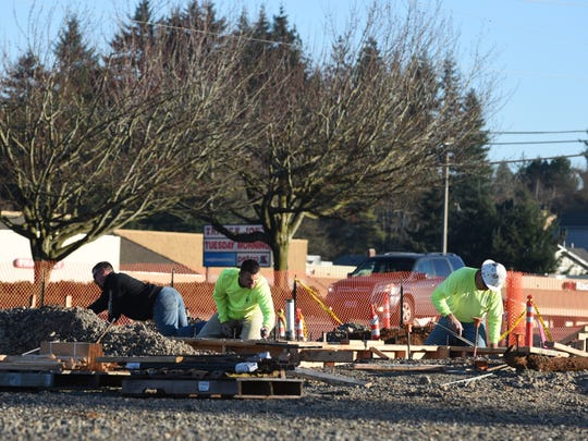 Construction is underway at the Firehouse Crossing site on Friday, Jan. 30, 2015, along Commercial at Hilfiker in South Salem.
