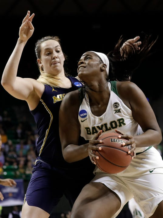 FILE - In this Sunday, March 18, 2018, file photo, Michigan center Hallie Thome (30) defends as Baylor center Kalani Brown works to the basket during the second half of a second-round game at the NCAA women's college basketball tournament in Waco, Texas. Even as basketball has gone away from tradition position players trending towards more versatile talents, there is a plethora of dominant post players like Teaira McCowan, Azura Stevens, A'ja Wilson and Kalani Brown leaving their mark in the women's NCAA Tournament. (AP Photo/Tony Gutierrez, File)