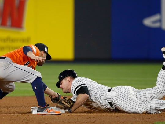Chase Headley slides in safely into second base during the eighth inning of the Yankees' 6-4 win over the Astros in Game 4 of the ALCS Tuesday night at Yankee Stadium.