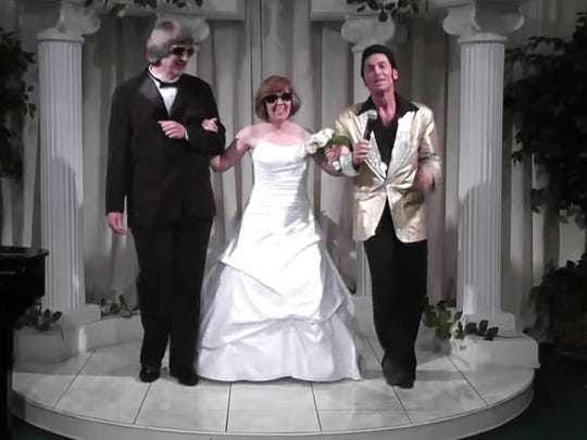 In this Oct. 29, 2011, image made from a video provided by A Elvis Chapel, David Allen Turpin, left, and his wife, Louise Anna Turpin, center, celebrate a renewal of their wedding vows with Elvis impersonator Kent Ripley in Las Vegas. The couple was arrested Sunday, Jan. 14, 2018, after authorities found their malnourished children in their home in suburban Perris, Calif.