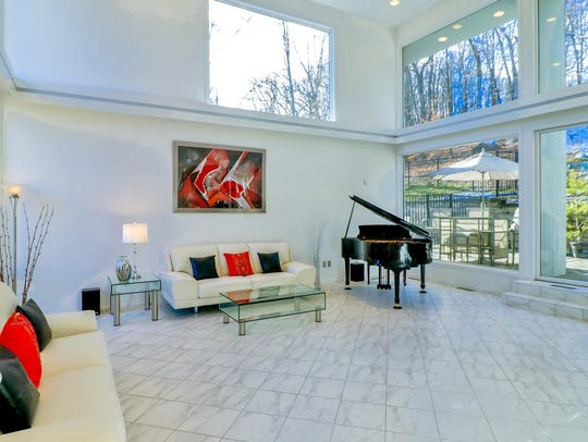 The living room of a contemporary home for sale in