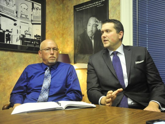 Bucyrus Fire Chief Jay Keller, left, and Attorney Adam